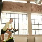 female exercising on a spin bike