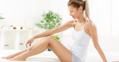 woman using epilator on legs