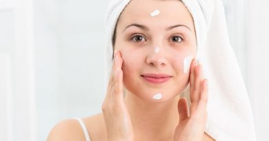 young female applying acne moisturizer
