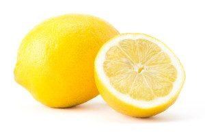 One and a half lemons on a white background.