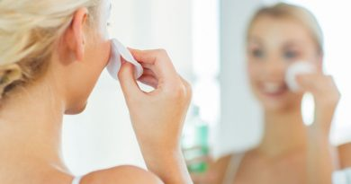 woman applying acne face toner
