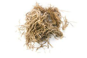 A pile of dried vetiver on a white background.