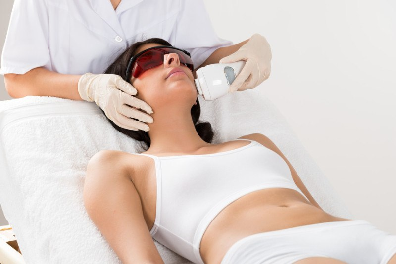 beautician-giving-epilation-laser-treatment