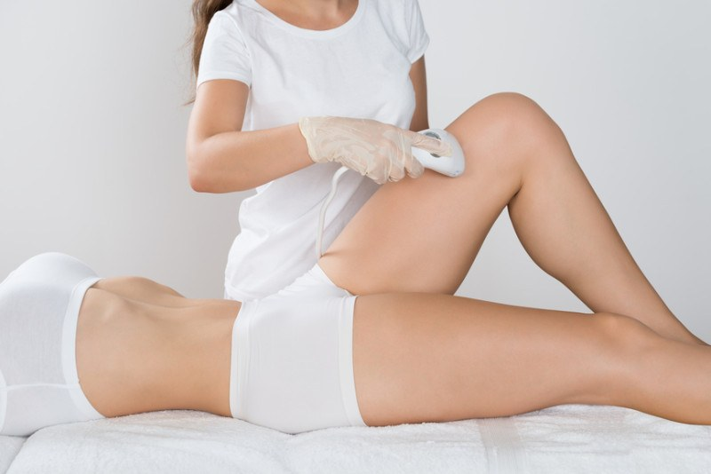 woman-having-laser-treatment-on-thigh