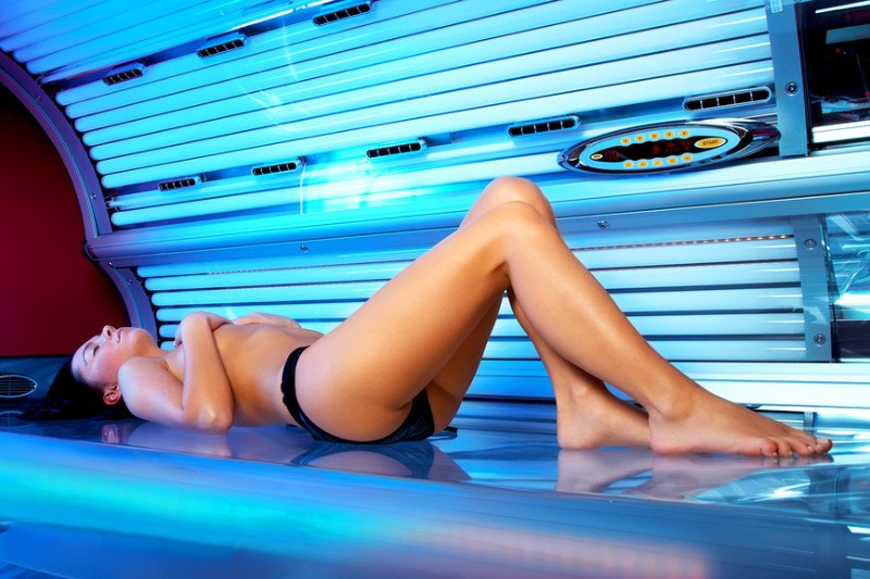 woman laying in an indoor tanning bed